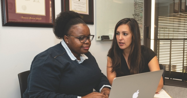 Bongeka Zuma (left), a medical student interested in cardiology, meeting with Fatima Rodriguez, MD, MPH.