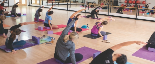 Residents stretch during a Women in Medicine-sponsored yoga class