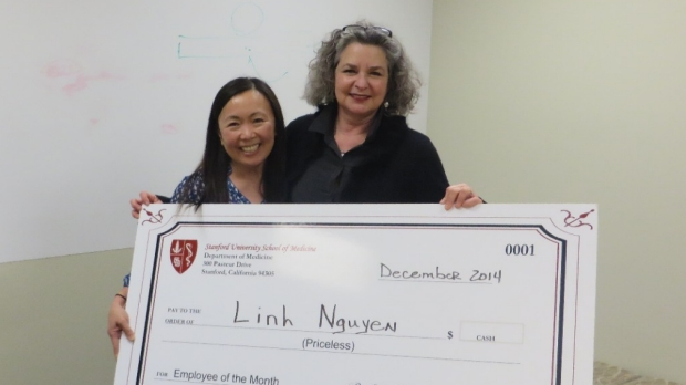 Linh Nguyen receives check award for being Dec. 2014's Employee of the Month
