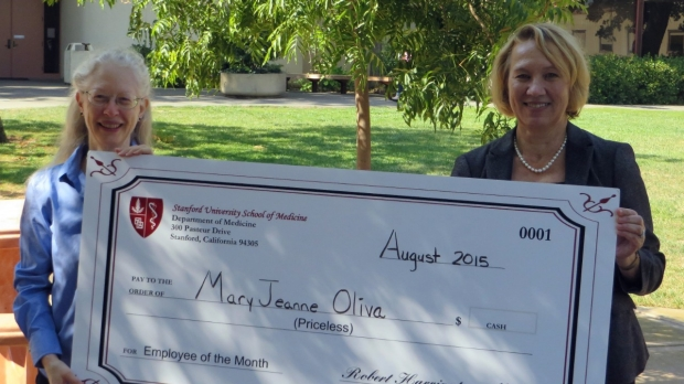 MaryJeanne receives check