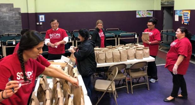 SCOPE volunteers bagging meals