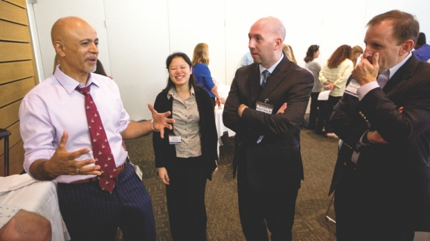 Abraham Verghese, MD, with symposium attendees