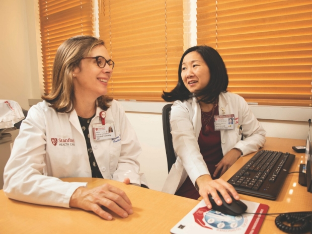 WINNIE TEUTEBERG, MD (left), and STEPHANIE HARMAN, MD, discuss the difficult conversations project
